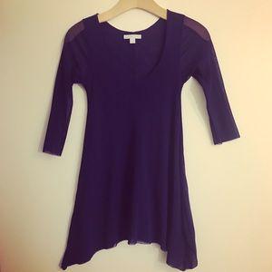 Dark purple sharkbite hem top with sheer sleeves